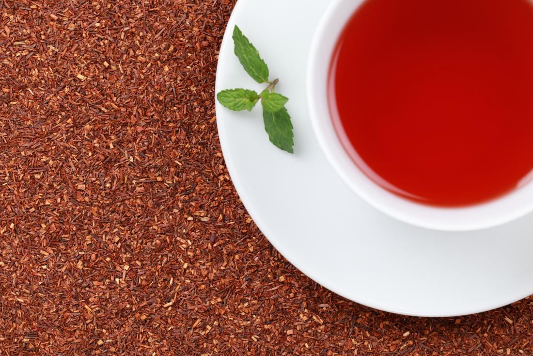 Red tea in white cup with leaf